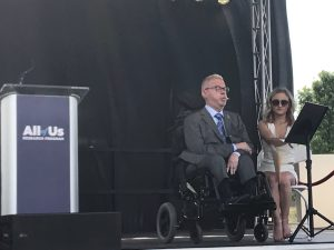 Picture of Gentleman in a wheelchair (Stephen Mikita) speaking at the All of Us launch event in Birmingham, AL