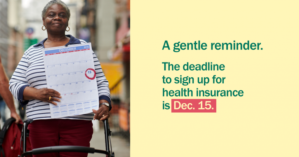 African American woman holding calendar with Dec. 15 circled with a gentle reminder that it's time to enroll for health insurance